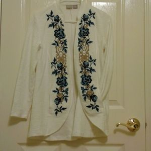 A lady's sweater in good condition from Chico's